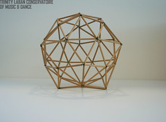 Dodecahedron: Model of the fifth of the Platonic solids. Used to orientate human movement. Made from wood and joined with metal screw-eyes.