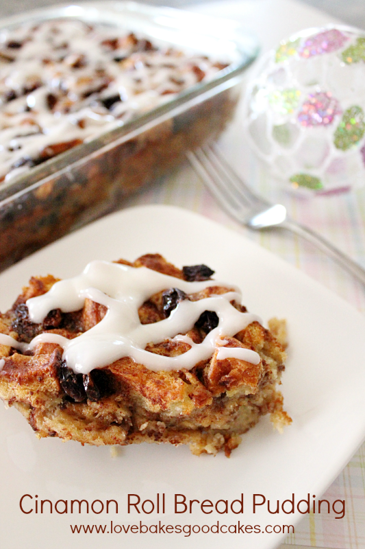 Cinnamon Roll Bread Pudding on a white plate with a fork.