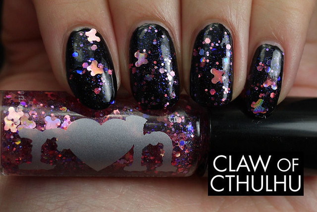 Rainbow Honey Papillion Swatch (over OPI Black Onyx)