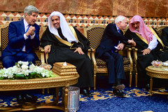 U.S. Secretary of State John Kerry and U.S. Senator John McCain of Arizona chat with members of the Saudi Royal Family after greeting the new King Salman of Saudi Arabia at the Erqa Royal Palace in Riyadh, Saudi Arabia, on January 27, 2015, and after joining President Obama, First Lady Michelle Obama, and other dignitaries in extending condolences to the late King Abdullah. [State Department photo/ Public Domain]