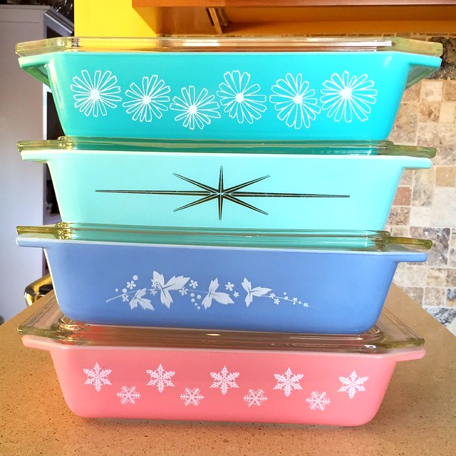 My newest favorite Pyrex space saver stack! Turquoise Daisy, Ice Blue starburst, periwinkle Hawthorn, & pink snowflake! :D