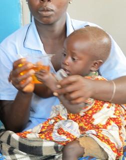 Child reaching for Kit Yamoyo