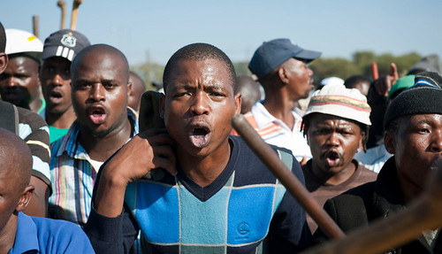 Mineworkers at Lonmin staged a one-day wildcat strike on May 14, 2013. Speculation exists that it is connected to the death of an Association of Mineworkers and Construction Union organizer just days before. by Pan-African News Wire File Photos