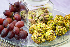 Blue Cheese Wrapped Grapes rolled in toasted, sugared pistachios with ground Chipotle Chile Peppers