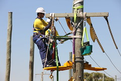 mast(0.0), wind(0.0), construction equipment(0.0), oil field(0.0), electrical supply(1.0), construction worker(1.0), electricity(1.0), person(1.0),