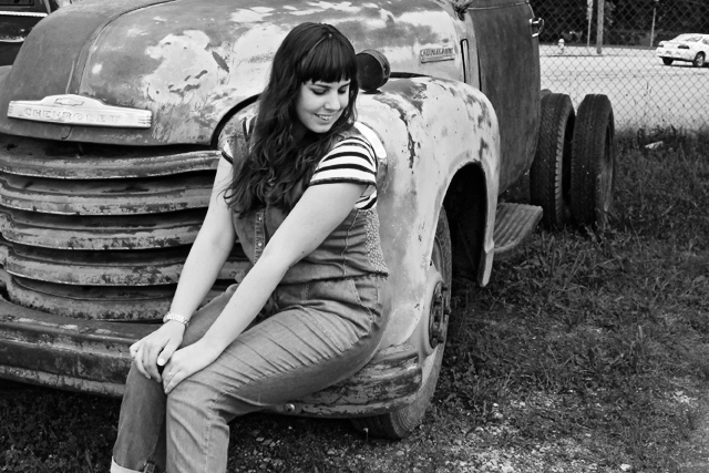 "Grays of Wrath outfit: Holding Horses ""denim jumper"" Anthropologie overalls, black and white striped Gap t-shirt, quilted black flats, antique truck"
