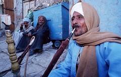 Egyptian men smoking water pipe