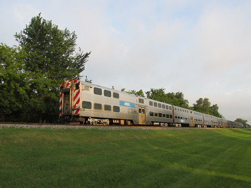 Southbound 5:40 AM Metra local commuter train departing from Glenview Illinois.  August 2013. by Eddie from Chicago