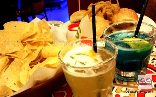 El Nino Margarita (left) & Blue Pacific Margarita (right); (Bottomless Tostada Chips with Skillet Queso and Big Mouth Burger Bites in the background)