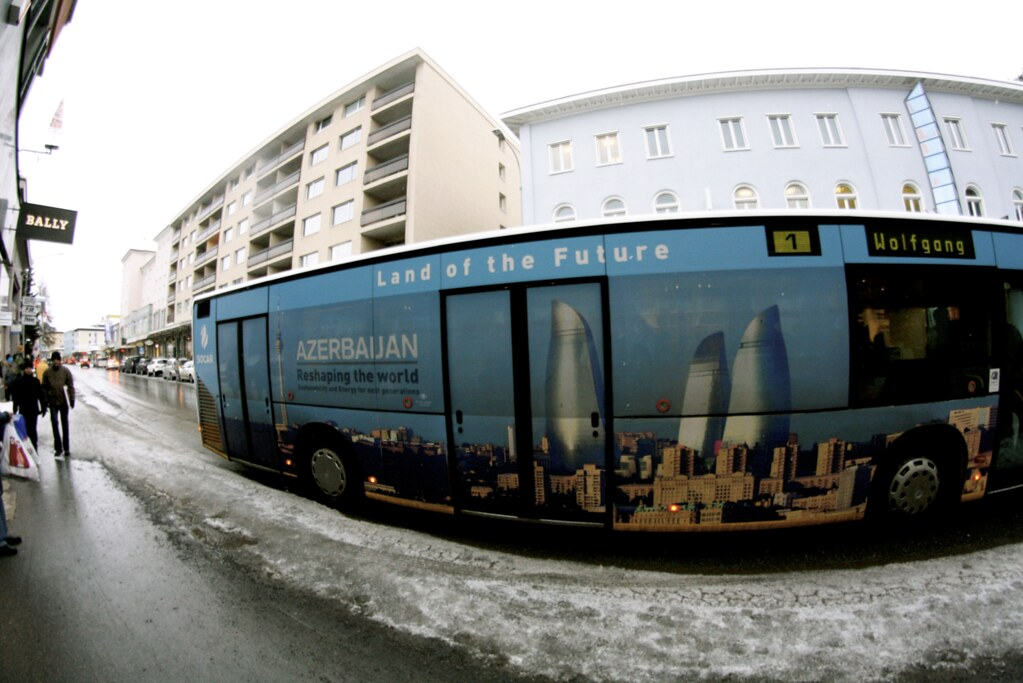 Azerbaijan has no more than seven participants at the Annual Meeting, but the state has covered many of the city buses with their advertisements that will be seen by the thousands of attendees.