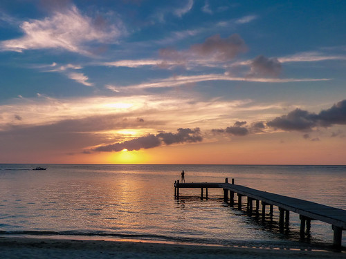 sunset sea sun beach water clouds pier waiting jetty shoreline calm shore romantic tranquil