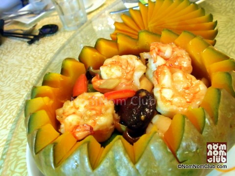 Sautéed Scallop & Prawn with Chicken & Assorted Mushroom served in Pumpkin