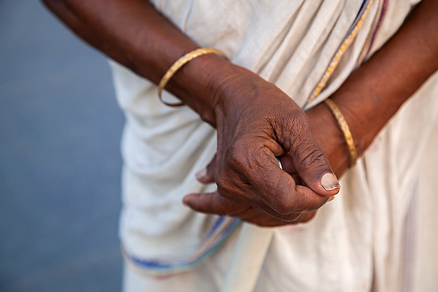 Hands of a woman in the streets of Kolkata, India.