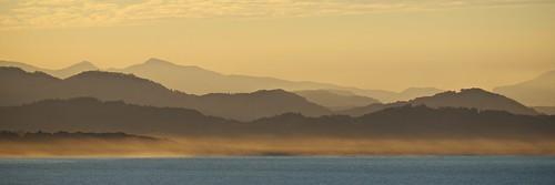 sunset brown mountains beach nature water misty landscape haze natural vivid australia coastal colourful