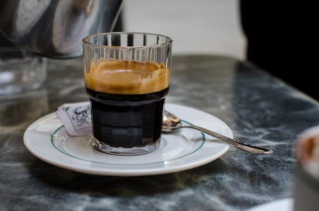 A shot of espresso waits for its milk.