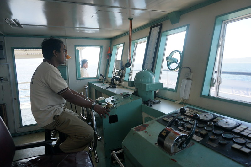 Captain steering ferry from Java to Bali