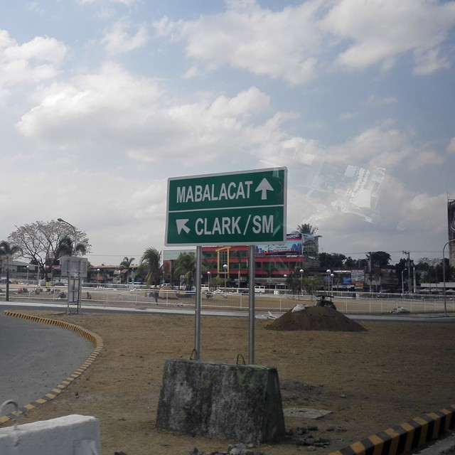 ROAD SIGN POINTING TO CLARK, PAMPANGA.
