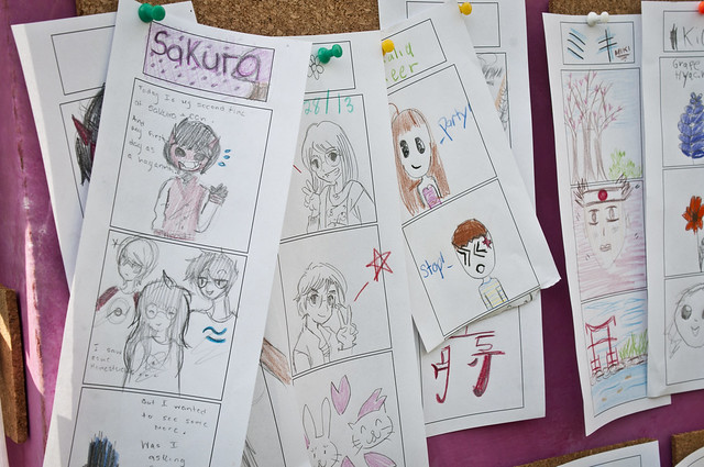 Sketches by visitors of their favorite Sakura Matsuri sightings pinned onto the J-Lounge Manga Journal. Photo by Mike Ratliff.