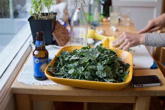 kale salad, hands