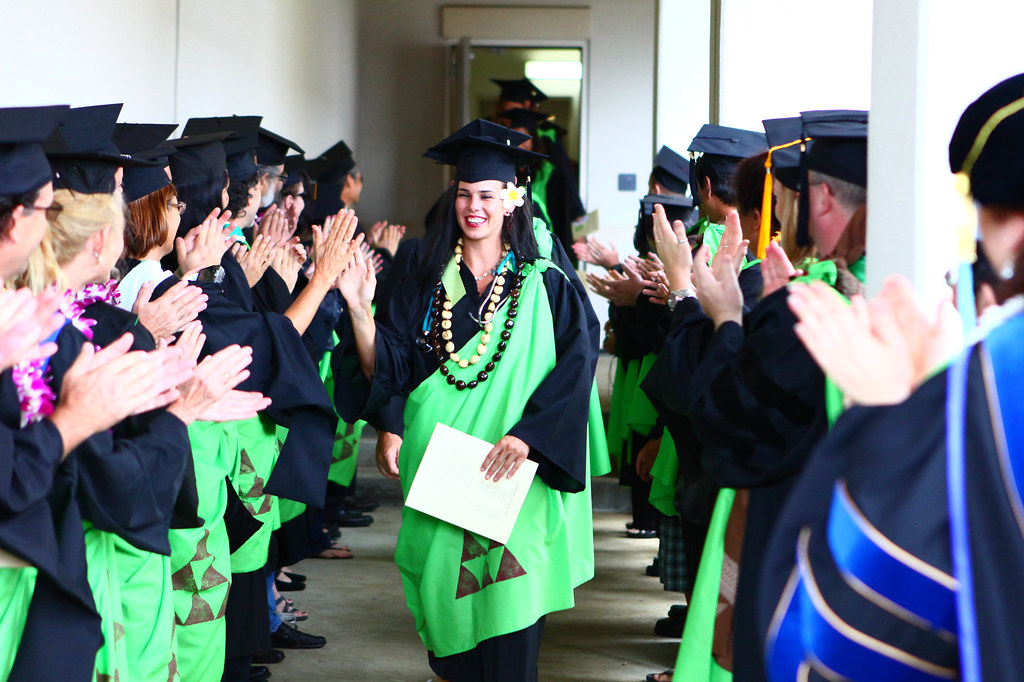 """<p>Jena Azura walks through a lineup of Windward CC faculty congratulating the graduates. May 11, 2013 (Photo by Peter Tully Owen)<br /> <br /> See more photos on the <a href=""""https://www.facebook.com/media/set/?set=a.428811667218250.1073741827.100002682609200&type=1"""" rel=""""nofollow"""">campus' Facebook page.</a></p>"""
