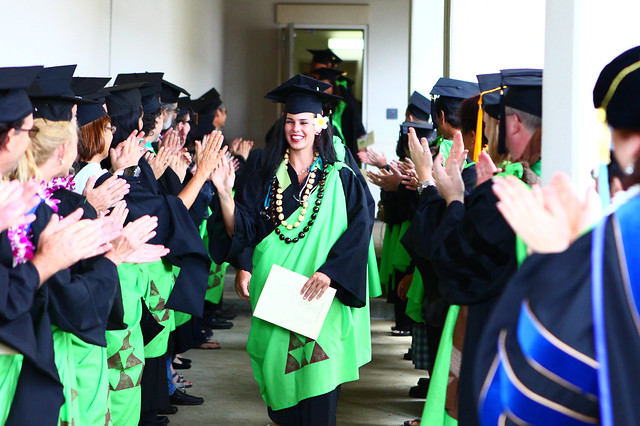 "<p>Jena Azura walks through a lineup of Windward CC faculty congratulating the graduates. May 11, 2013 (Photo by Peter Tully Owen)<br /> <br /> See more photos on the <a href=""https://www.facebook.com/media/set/?set=a.428811667218250.1073741827.100002682609200&type=1"" rel=""nofollow"">campus' Facebook page.</a></p>"