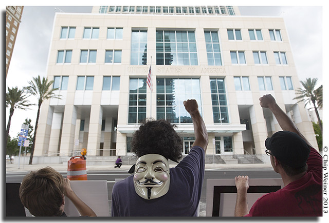 Occupy TAmpa members rally across from Fedral Courthouse