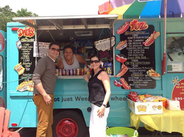 Rosie's Weenie Wagon pictured is Rosie with customers at Food Truck