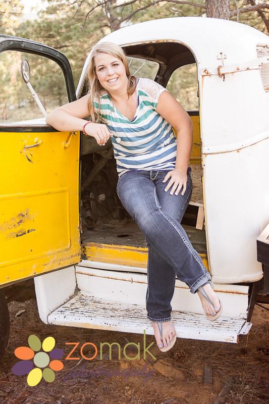 helena montana high school girl sitting in old farm truck