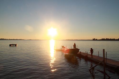 sunset summer sun sunlight lake ontario canada wet water sunshine silhouette canon eos pier boat glare sunny westlake lakeontario sandbanks 50d