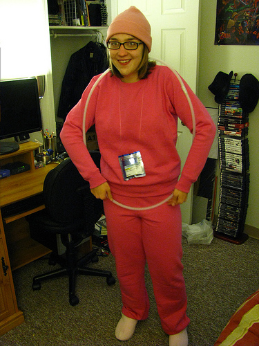 A woman is dressed up in pink as a Nuvaring