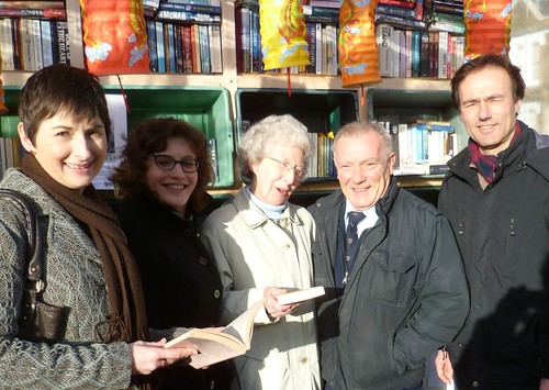 CCaroline Pidgeon with Councillor Barry Cheese and Councillor Paul Lorber in front of bookshelves with books