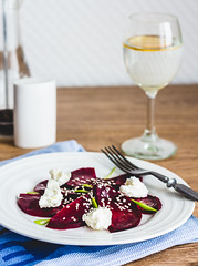 beet salad with goat cheese, garlic and sesame see…