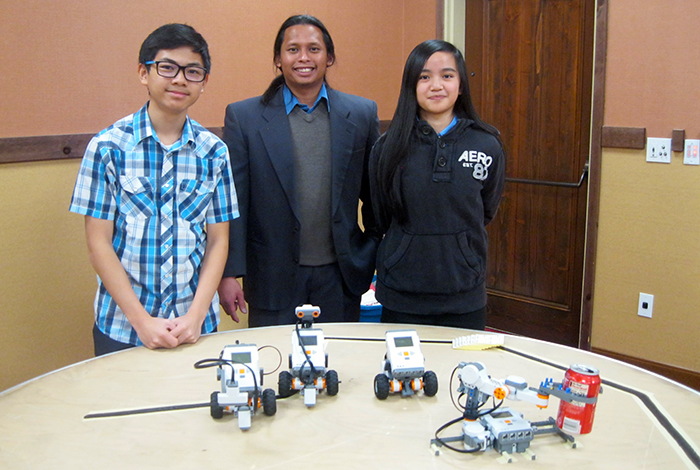 RoboRAVE facilitator Ian Cainglet (middle) with student participants.