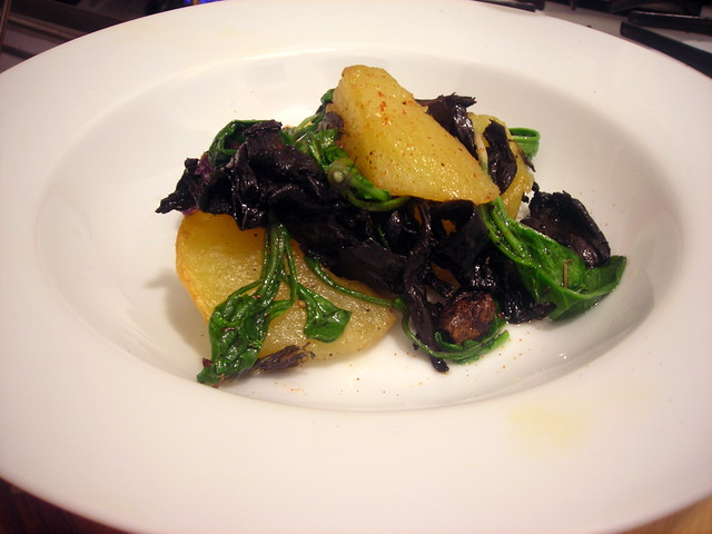 Crispy heirloom potatoes, black trumpet mushrooms, baby arugula