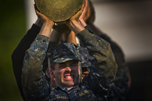 <p>U.S. Naval Academy midshipmen with the Class of 2016 conduct a log carrying exercise as part of the U.S. Naval Academy Sea Trials in Annapolis, Md., May 14, 2013. Based on the Navy's Battle Stations and the Marine Corps' Crucible, Sea Trials were the capstone training evolution for the Naval Academy freshmen class. The midshipmen navigated physical and mental challenges, ranging from obstacle courses, long-distance group runs, damage control scenarios, and water training. (DoD photo by Mass Communication Specialist 2nd Class Todd Frantom, U.S. Navy/Released)</p>