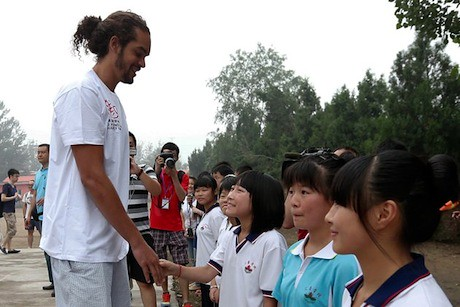 June 30th, 2012 - Joakim Noah meets children at a primary school for children of migrant workers at Changping District in Beijing