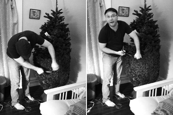 Husband sets up the Christmas tree