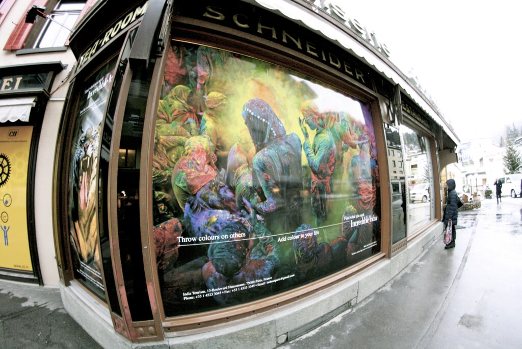 "Following the example of fellow Asian nations, India also advertises its traditions on the streets of Davos. A picture of the Holi festival (""Festival of Colours"") in India covers the windows of this Schneider café, a popular spot for meetings and corporate events."