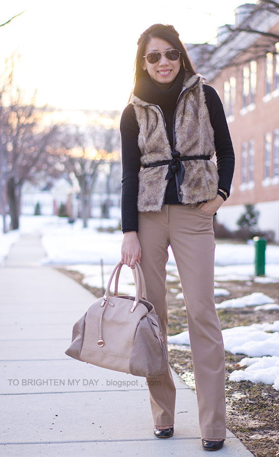 faux fur vest, black turtleneck sweater, camel pants