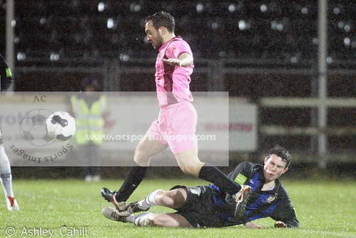 Mark Hughes slides in on Peter Higgins during Wednesday Leinster Senior Cup tie against Wexford Youths. Photo:Ashley Cahill/AC Sports Images