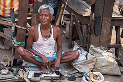 Shoe maker in the streets of Kolkata, India.