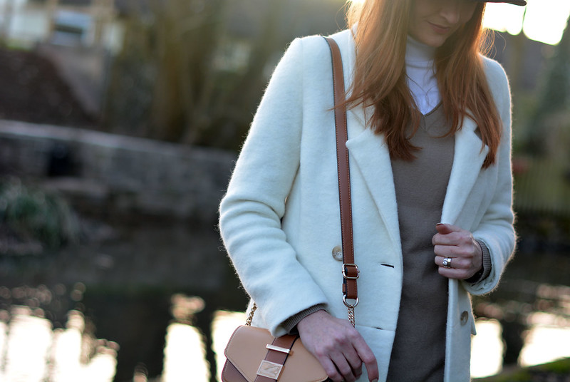 Winter white coat, fedora and roll neck