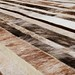 Small photo of Stripes Design Cowhide Patchwork Rug