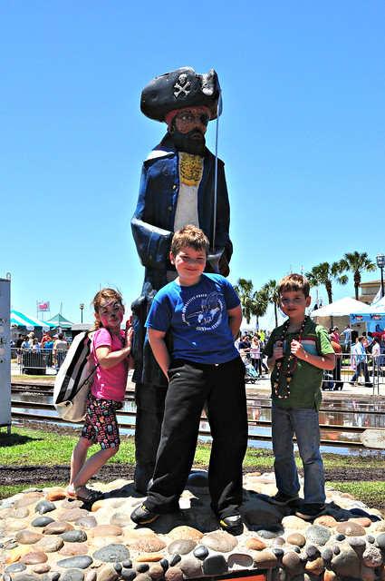Kids and a Pirate Statue