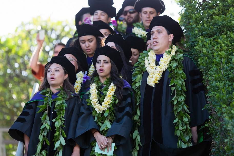 """<p>Members of the 2013 William S. Richardson School of Law graduating class receiving Native Hawaiian Law Certificates chant an oli for the assemblage at the school's commencement ceremony. May 12, 2013. (Photos by Mike Orbito)<br /> <br /> For more photos go to the <a href=""""https://picasaweb.google.com/lawschoolphotos/20130512ToastAndCommencement?authuser=0&authkey=Gv1sRgCLySgIWT2rmxKg&feat=directlink"""" rel=""""nofollow""""> School of Law's Picasa album</a></p>"""