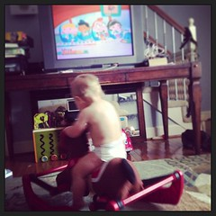 Giddy Up!! How my little cowboy likes to watch TV :)