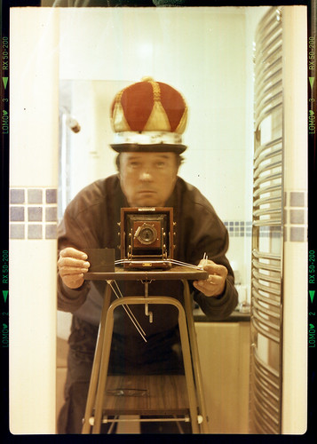 reflected self-portrait with Lancaster Instantograph camera and bowler crown by pho-Tony