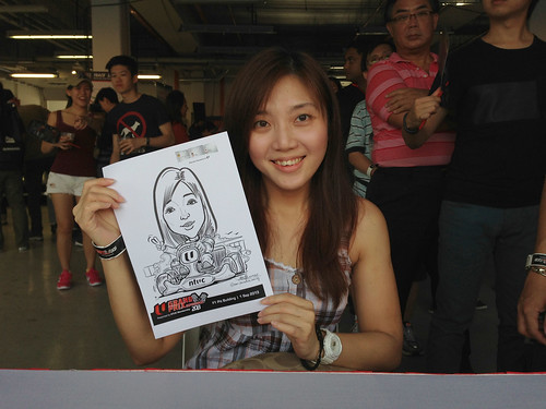 caricature live sketching for NTUC U Grand Prix Experience 2013 - 8