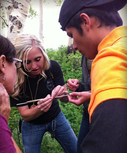 Sierra Hellstrom, Nature High Summer Camp director, explains to student about the core sample taken from an aspen tree.