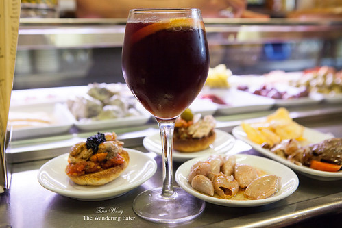 Glass of (excellent) sangria with my spread of tapas